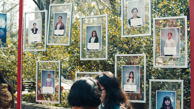 """Women go to a """"marriage market"""" in Shanghai, but instead of seeking partners, they post messages celebrating their singledom and asking their parents to understand their viewpoint. Photo Credit: Google"""