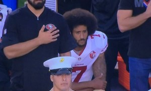 Kaepernick Sitting during national anthem