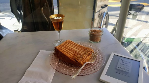 At a cafe in San Francisco with Honey Cake and Kindle