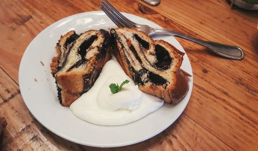 Two slices of Babka with a side of cream