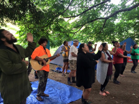 Our River Guides performing a waiata as we get our breakfast on the last morning of the river trip at Puraroto. Photo Credit: Jay Roberts