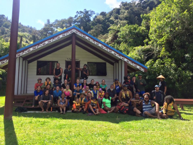 All of the us with our guides and the film crew at Tieke Marae in front of the Whare on the morning of the second to last day. A Marae is a sacred place to the Maori because it holds historical or cultural importance like the site of a battle or a burial ground. The Whare is the building that is on the Marae. Photo Credit: Jay Roberts