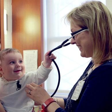 Baby pulling stethoscope. Photo courtesy Mount Sinai Parenting Center