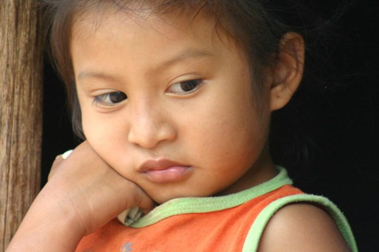 Young Latina girl, looking sad
