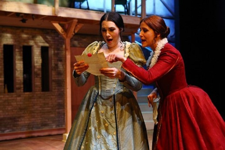 Mistress Page (Lydia Mackay) and Mistress Ford (Trisha Miller) discover Falstaff's deceit in the Trinity Shakespeare Festival production of The Merry Wives of Windsor, 2012.