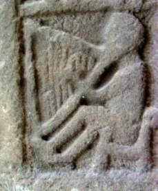 One of the Pictish stone harpers from Monifeith, c. 8th century.