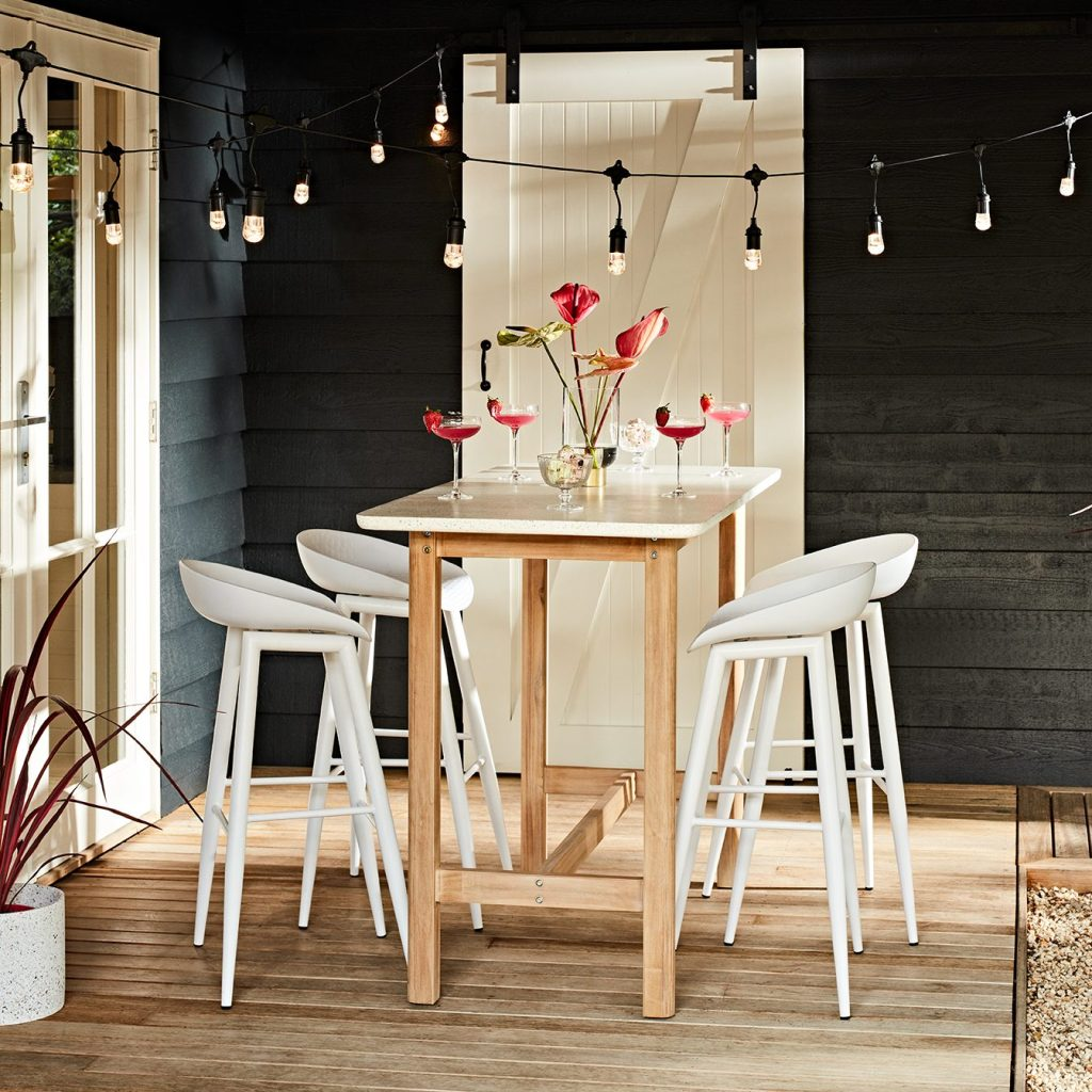 Blissful Balcony Decorating Ideas with Terrazzo Bar Table and festoon lights