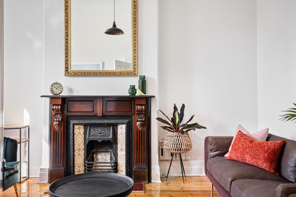 Update Your Period Home Without Losing its Charm with Adela Sofa and fireplace