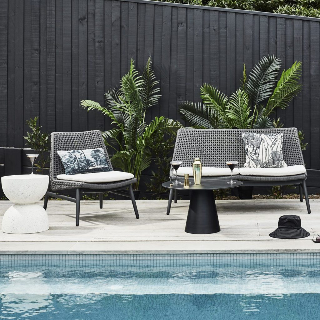 Perfect Plants for Poolside Landscaping with cane palm