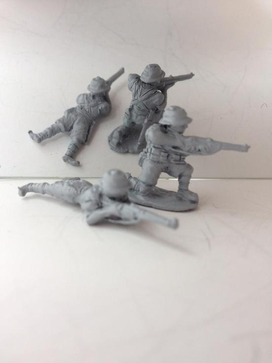 2 X British Infantry firing rifles in different poses.
