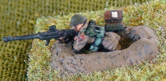 1 Rifleman/gunner firing Boyes ATR in 1 man fox hole