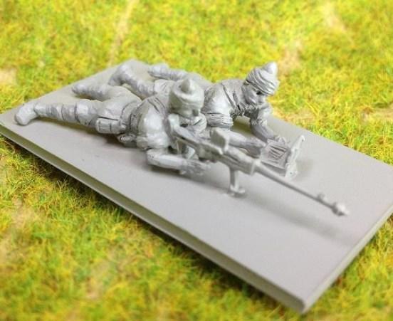2 x Indian Infantry, firing Boyes anti-tank rifle prone