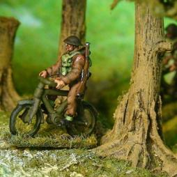 British Infantryman on seperate bicycle with rifle
