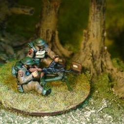 2 x Bren gunner firing Bren gun on sustained fire