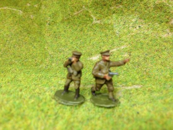 (TL) 2 Officers 1 with pistol advancing, other with binoculars
