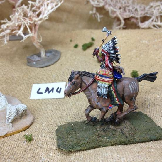 Sioux warrior mounted on horse, wearing feathered bonnet, armour