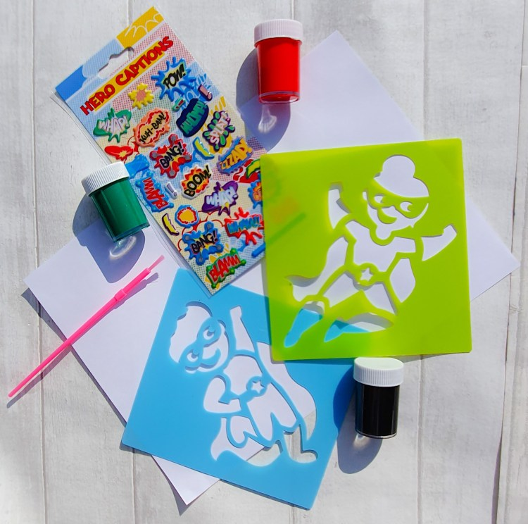 design it pack from the super hero themed early years fun subscription box for 3 to 6 year olds. contains paper, super hero stencils, paints and stickers to make a super hero picture.