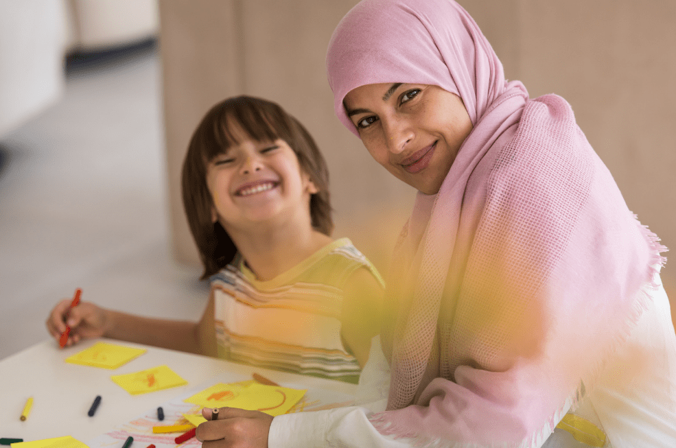 child and mother doing an art activity together
