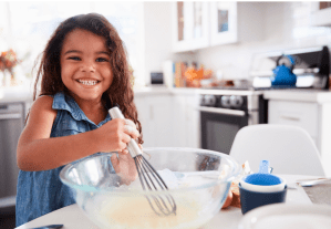 child baking with a smile