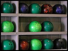 shelves of bowling balls