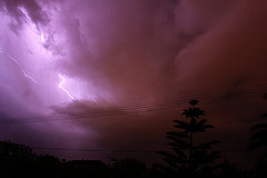 lightning flash against purple sky