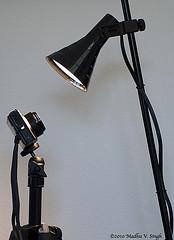tall light aimed down at small camera