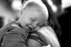 toddler hugging mom, smiling with joy
