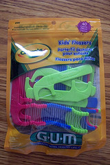 package of colorful kid friendly dental flossers