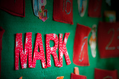 the name 'mark' cut in felt letters and hanging on wall