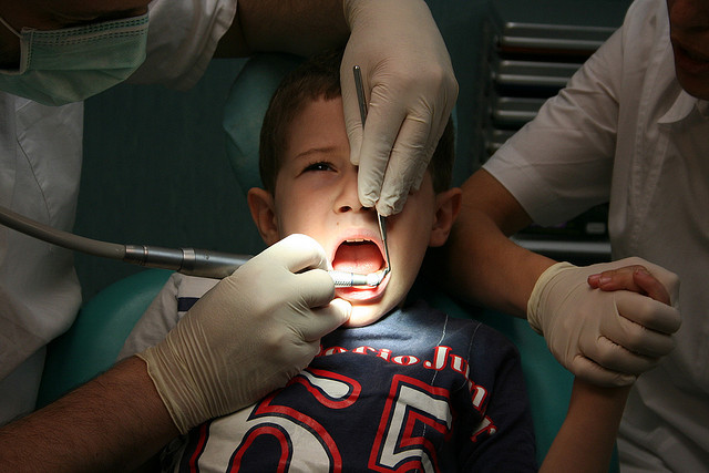 boy in dentist chair looking scared