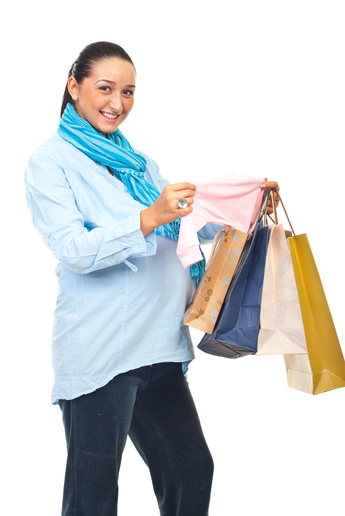 pregnant woman holding shopping bags and baby items