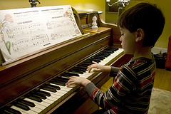 boy practicing piano
