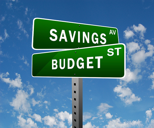 street sign saying savings and budget