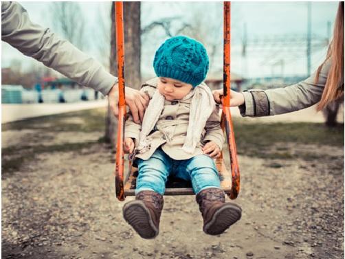 toddler on swing