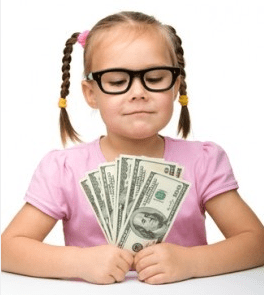 girl holding dollars in her hands