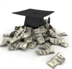 graduation cap on pile of dollars