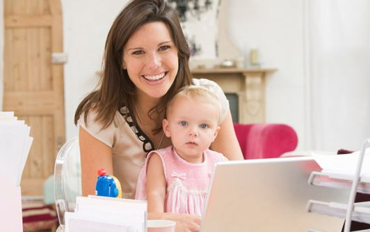 mom with daughter in front of laptop computer