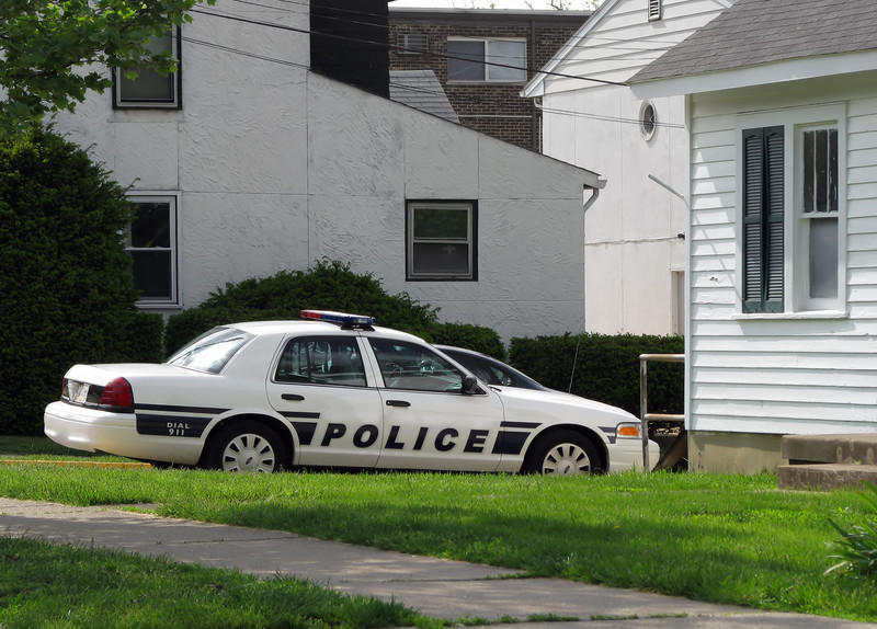 police car parked in front of house