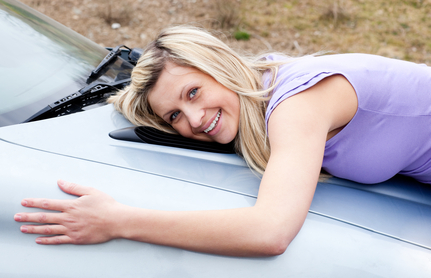 teen girl hugging new car