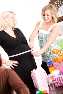 pregnant mom being measured at a baby party
