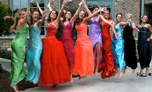 group of happy girls all dressed in formal gowns for prom