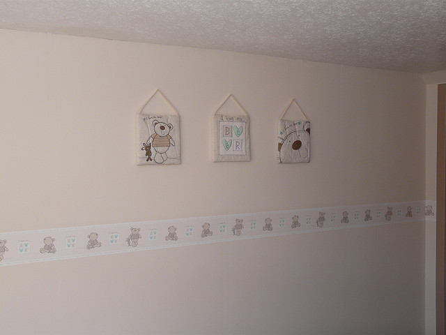 hand made wall decorations in a baby's room
