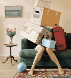 woman on couch covered with moving boxes