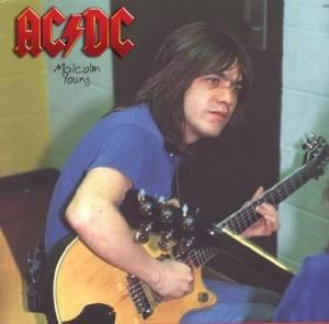 MalcolmBackstageTuningUpCirca1983