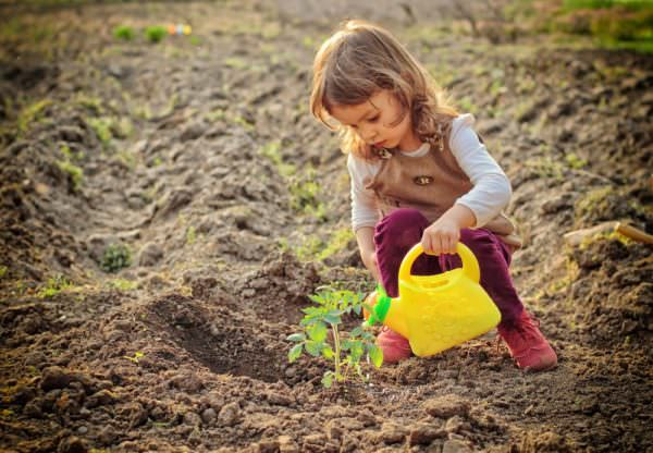 Young girl gardening outside