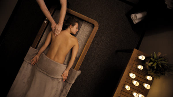 bird's eye view of woman receiving a shoulder massage