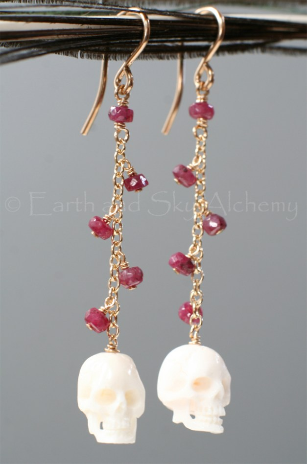 Ruby and buffalo bone skull earrings