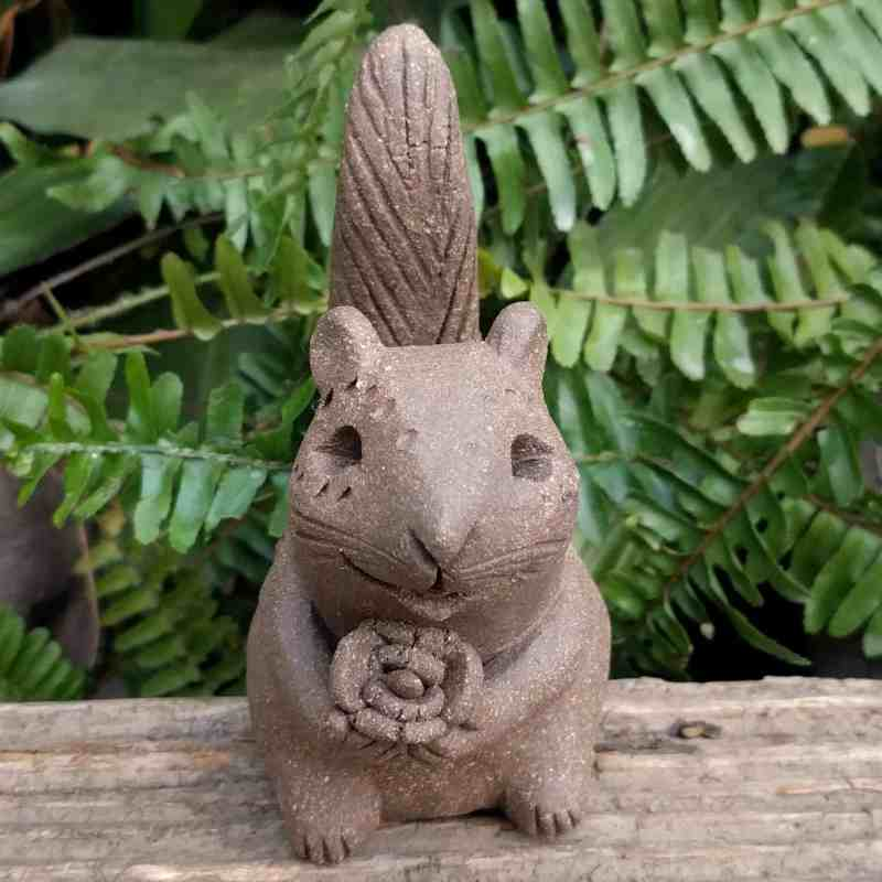 ceramic-chipmunk-holding-flower-tail-up-outdoor-statue-by-margaret-hudson-earth-arts-studio-2