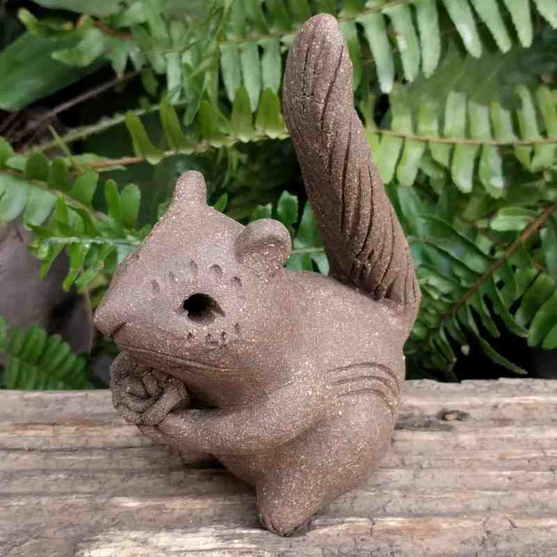 pottery-chipmunk-holding-flower-tail-up-outdoor-statue-by-margaret-hudson-earth-arts-studio-0