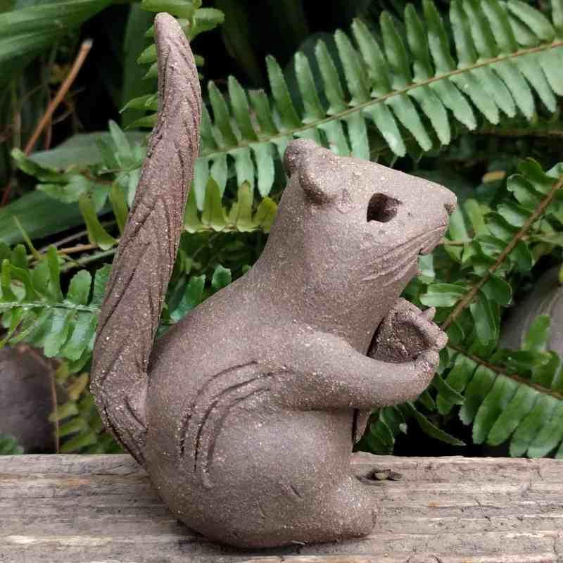 stoneware-chipmunk-holding-flower-tail-up-garden-sculpture-by-margaret-hudson-earth-arts-studio-5